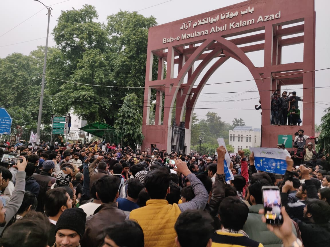 Jamia Millia Islamia University students raise slogans in protest against the Citizenship Act, in New Delhi, on Friday, December 13, 2019.