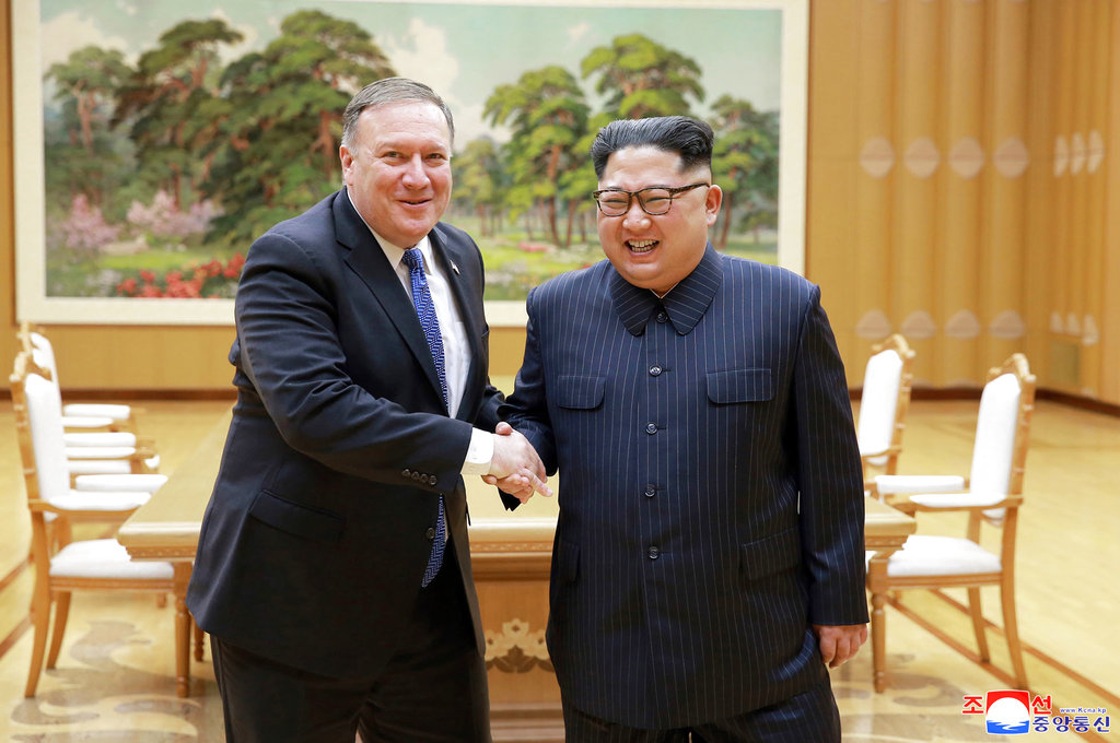 In this May 9, 2018, file photo provided by the North Korean government, US secretary of state Mike Pompeo (left) shakes hands with North Korean leader Kim Jong-un during a meeting in Pyongyang, North Korea.