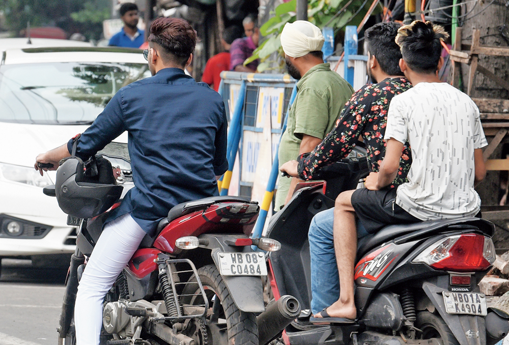 Bikers without helmets on Syed Amir Ali Avenue, Park Circus