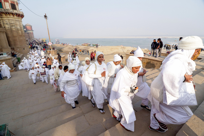 Jain devotees visit Assi Ghat during their Atma Shanti Yatra, in Varanasi, on Tuesday