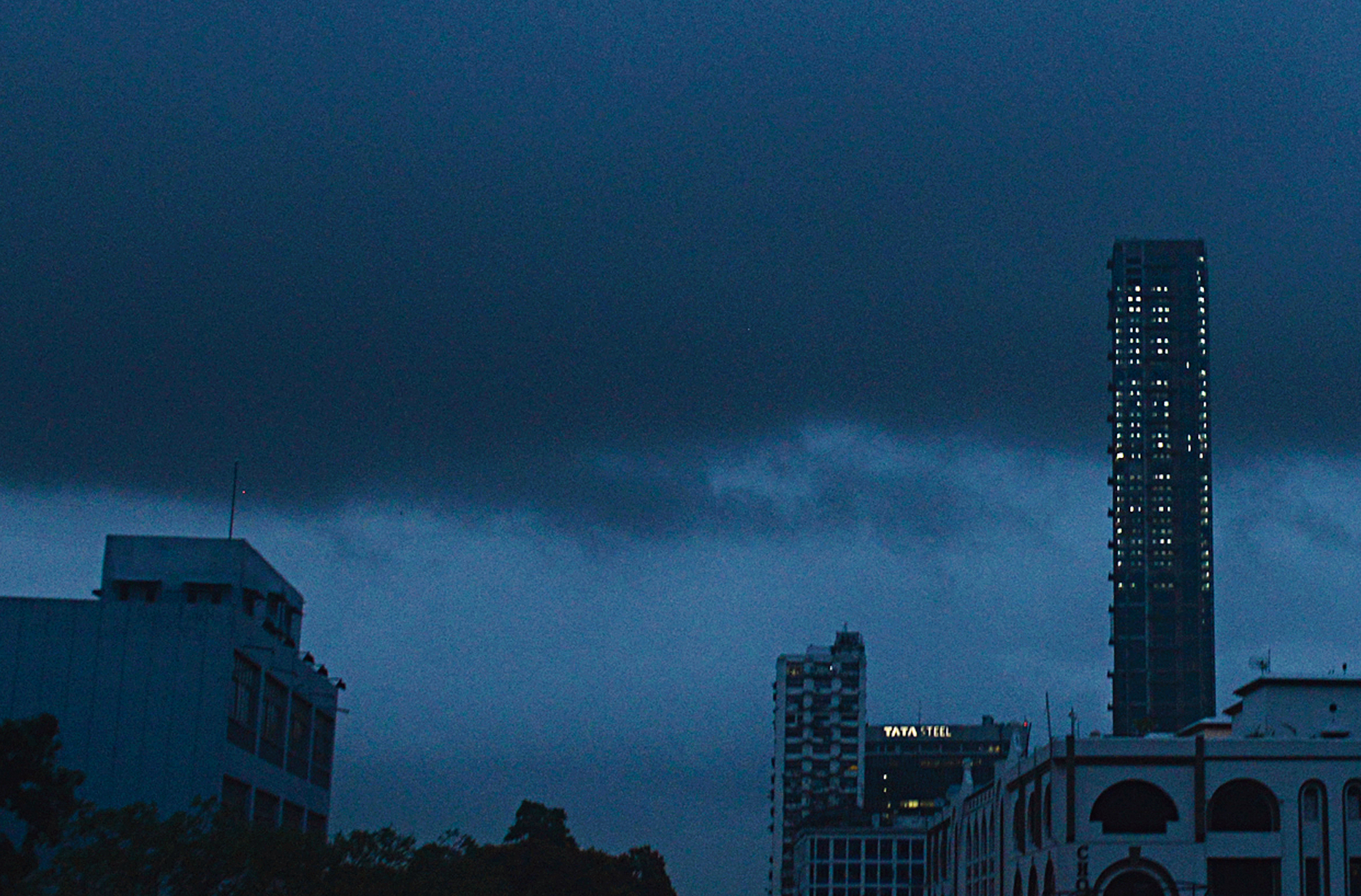 The 42, Calcutta's tallest building in the making, stands under a blanket of dark clouds around 6pm on Friday.