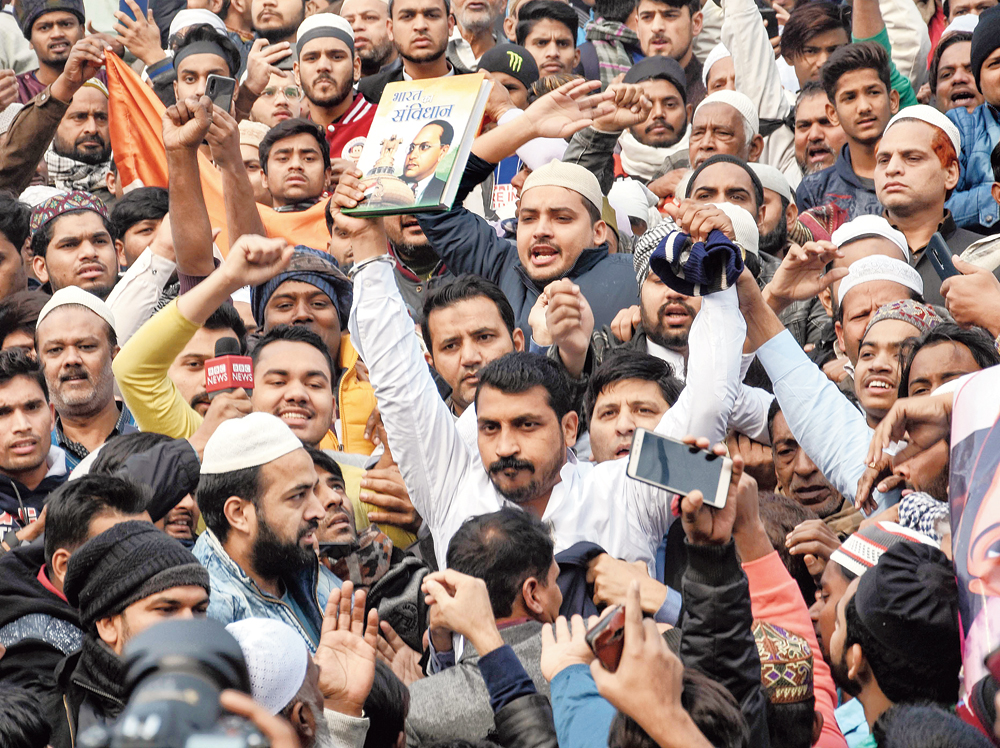 Chandrashekhar Azad at Friday's peaceful protest at Jama Masjid with the Indian Constitution in his hand.