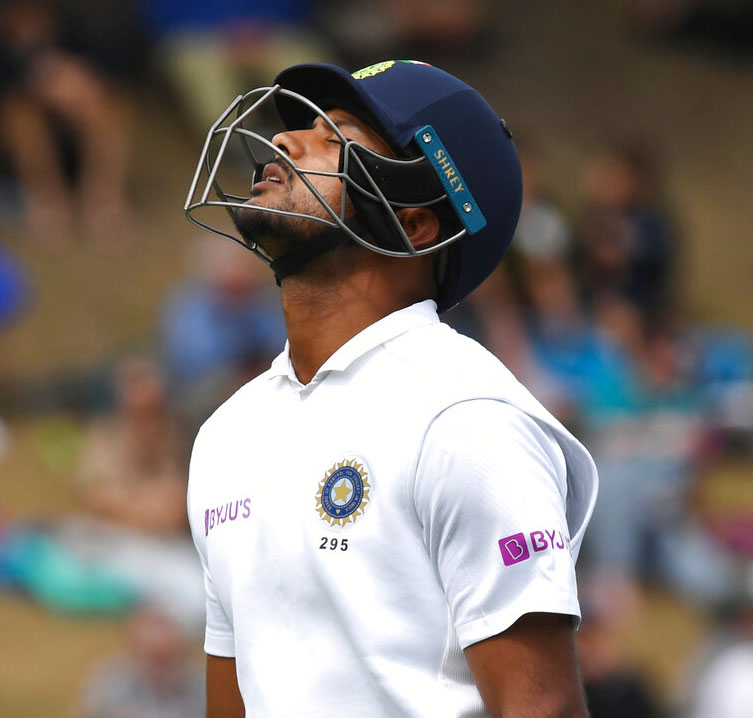 Mayank Agarwal reacts after being dismissed by New Zealand's Trent Boult for 34 during the first cricket test between India and New Zealand at the Basin Reserve in Wellington on Friday