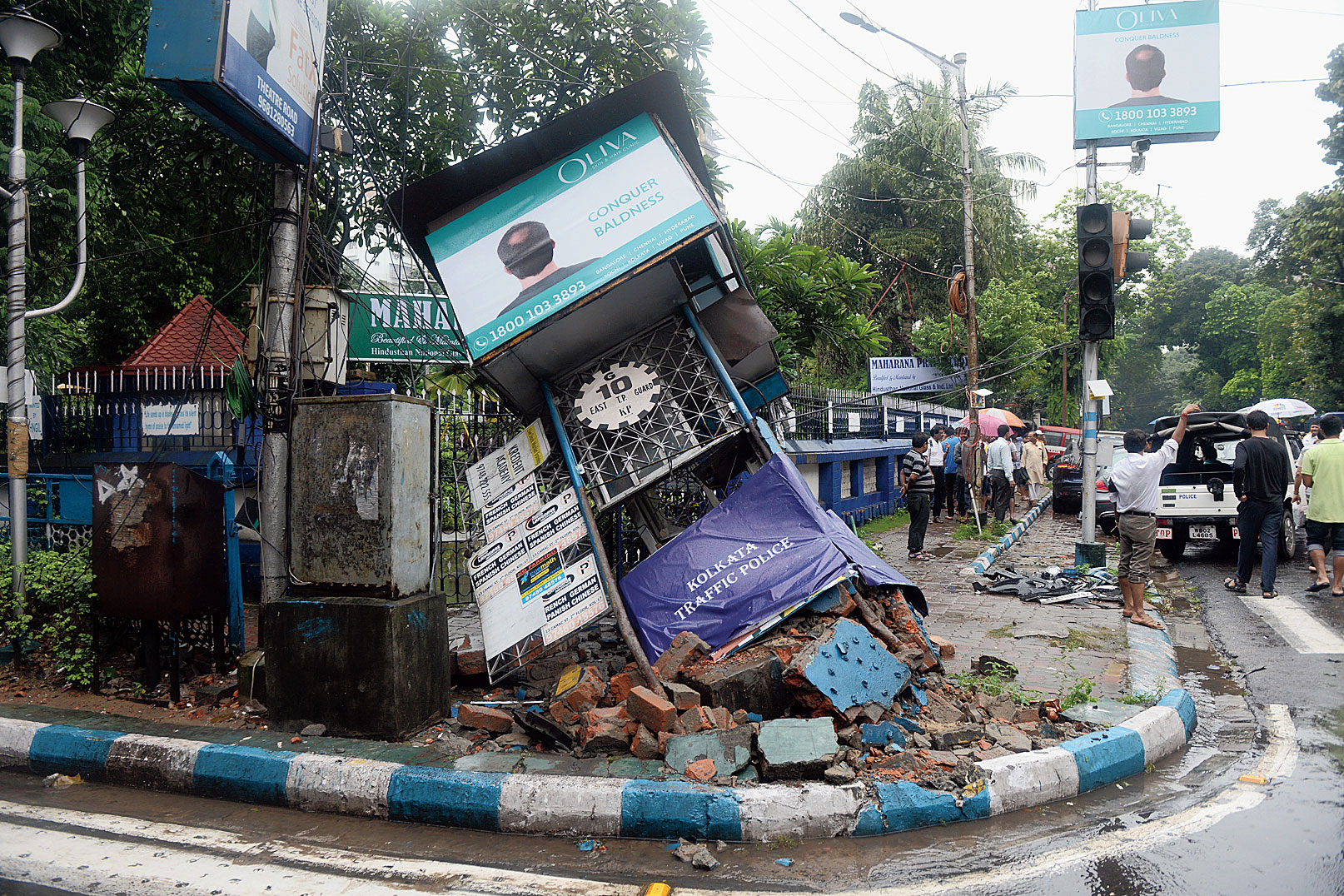 The damaged police kiosk opposite Shakespeare Sarani police station after it was hit by the Mercedes that veered off its path when the Jaguar rammed into it. Two of the three Bangladeshi tourists, who were standing in front of the kiosk, died when the Mercedes hit them with great force.