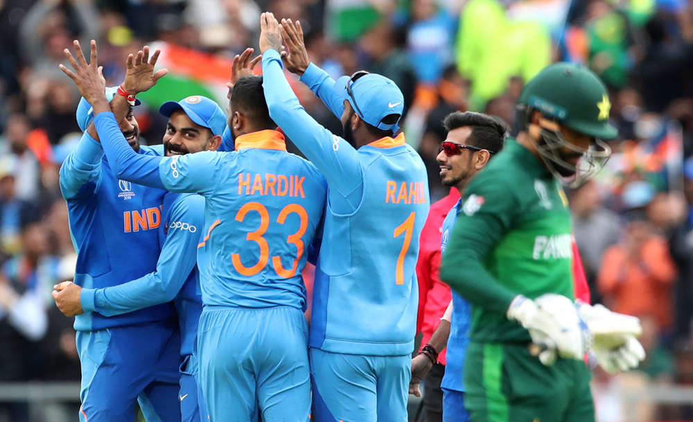Indian players celebrate the dismissal of Pakistan's Mohammad Hafeez during the match at Old Trafford in Manchester on Sunday