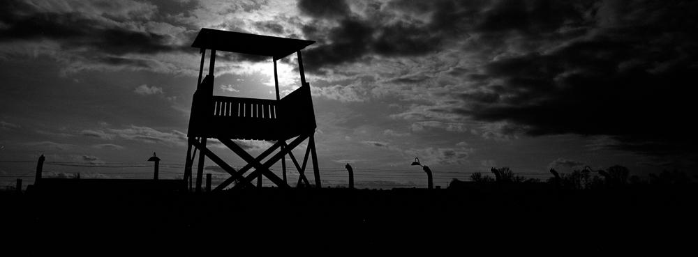 An observation tower stands inside the former Nazi death camp of Auschwitz Birkenau or Auschwitz II in Oswiecim, Poland