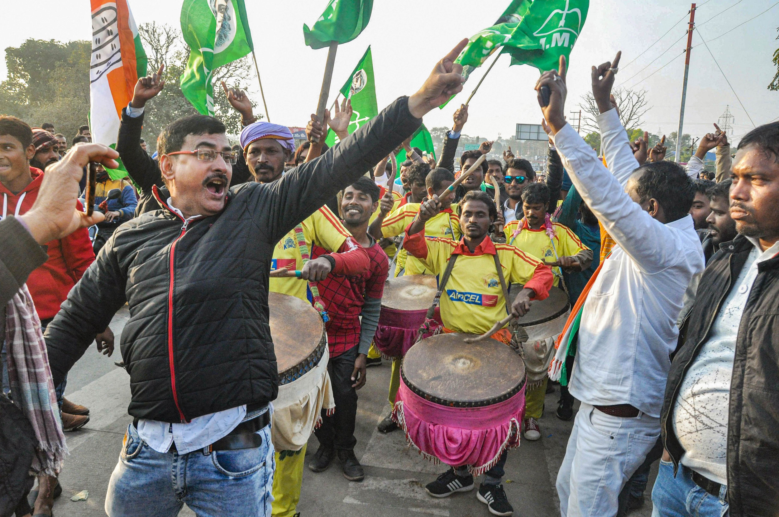 Party workers and supporters of Congress and JMM celebrate during Jharkhand Assembly election results in Ranchi on Monday.