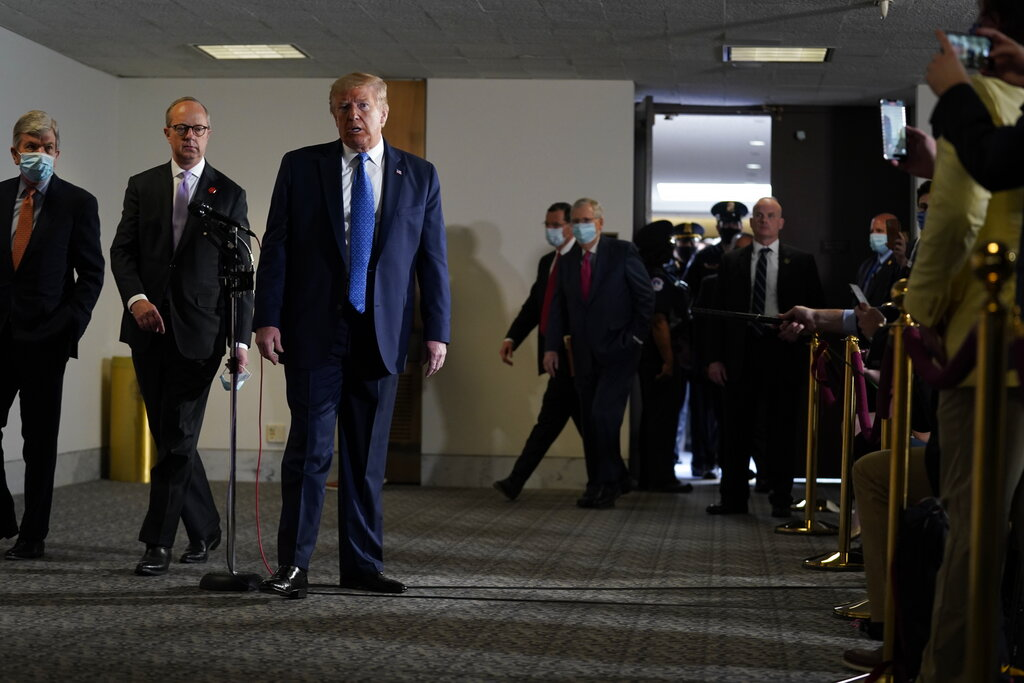 President Donald Trump arrives to speak during a visit to Capitol Hill to meet with Republican lawmakers