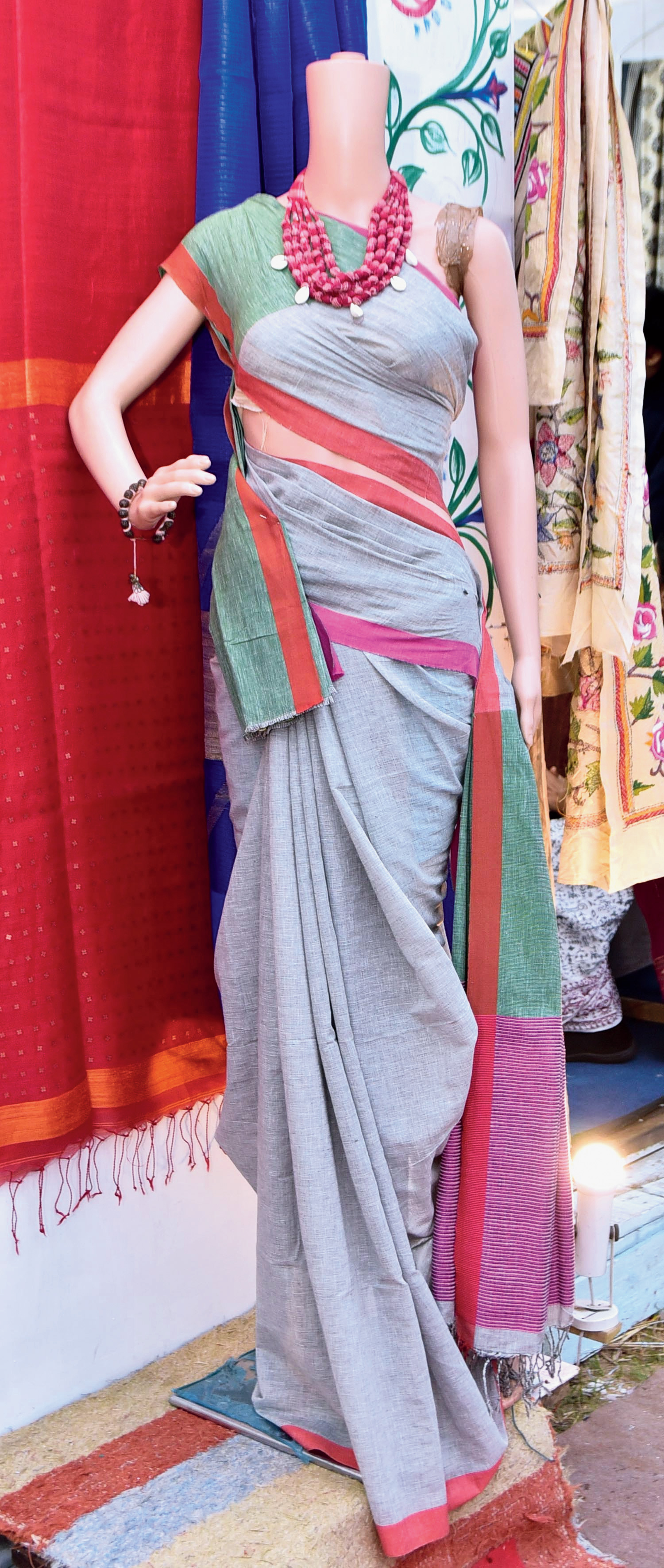 A khadi sari draped on a mannequin.