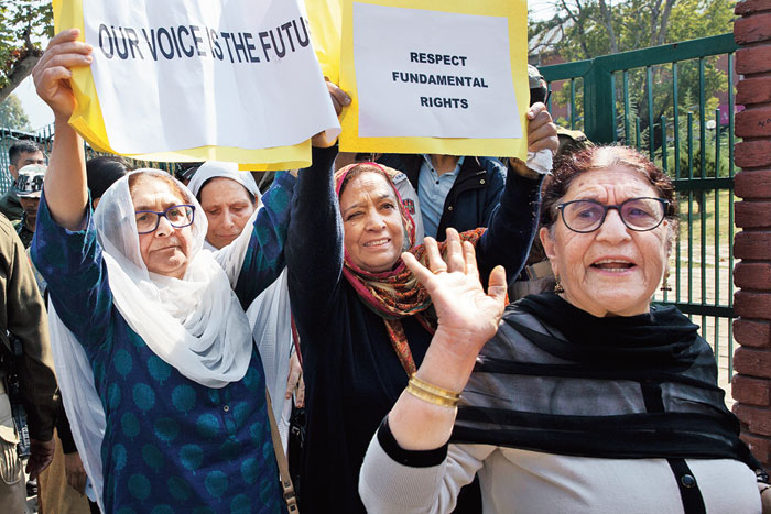 The group of women, under the banner of Women of Kashmir, hold placards at the protest in Srinagar on Tuesday.