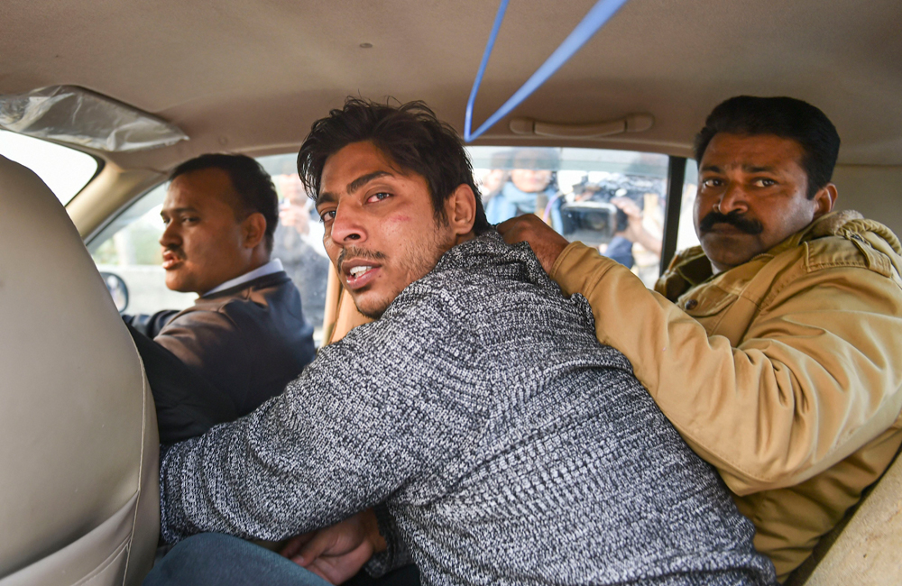 Kapil Gujjar being taken away by police on Saturday