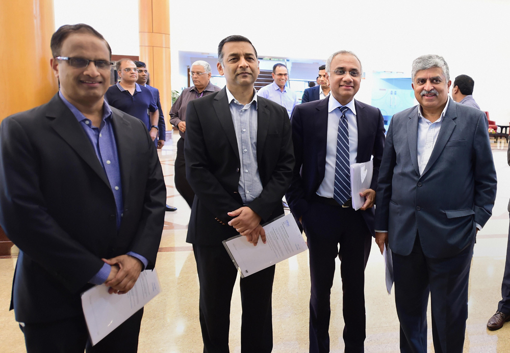 Infosys chairman Nandan Nilekani, CEO Salil Parekh, CFO Nilanjan Roy and COO Pravin in Bangalore on Friday