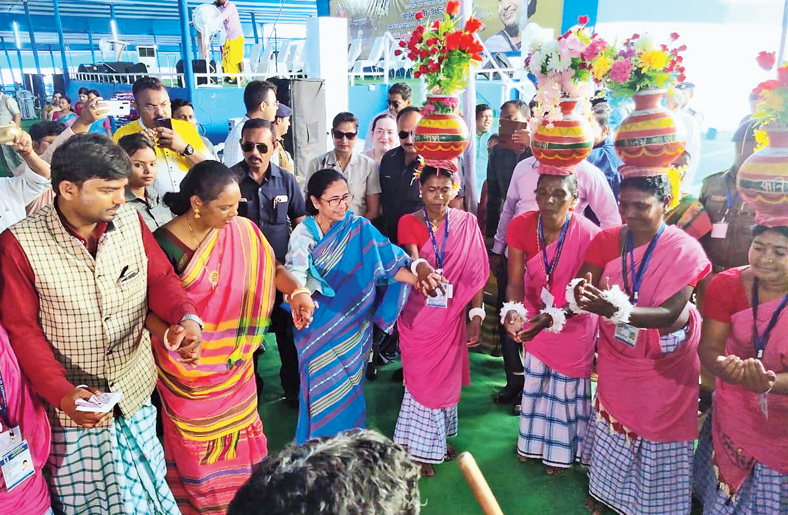 Mamata Banerjee dances with tribal women at the mass marriage ceremony in Malda's Gazole on Thursday.