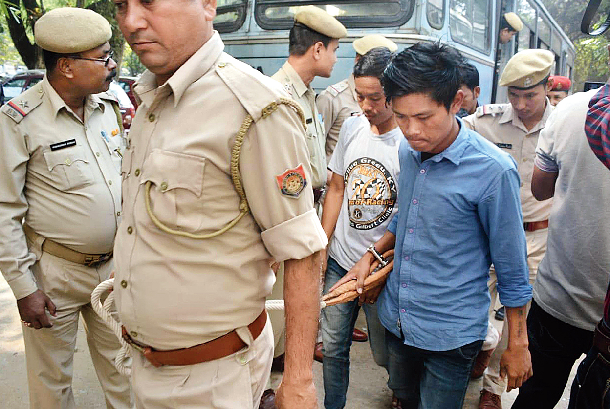 Two of the accused being produced in court in Nagaon on Thursday.