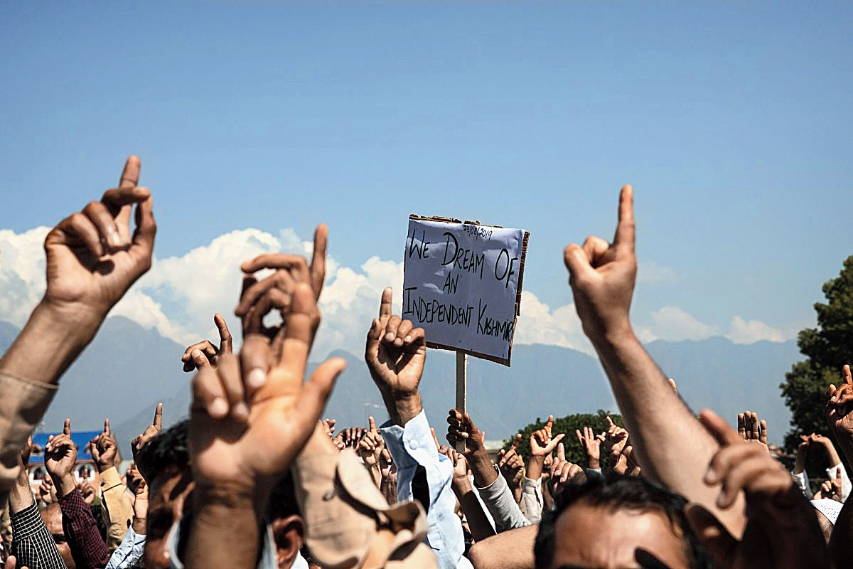 Kashmiri men shout slogans in Srinagar during a protest against New Delhi's tightened grip on the region  on August 23, 2019.