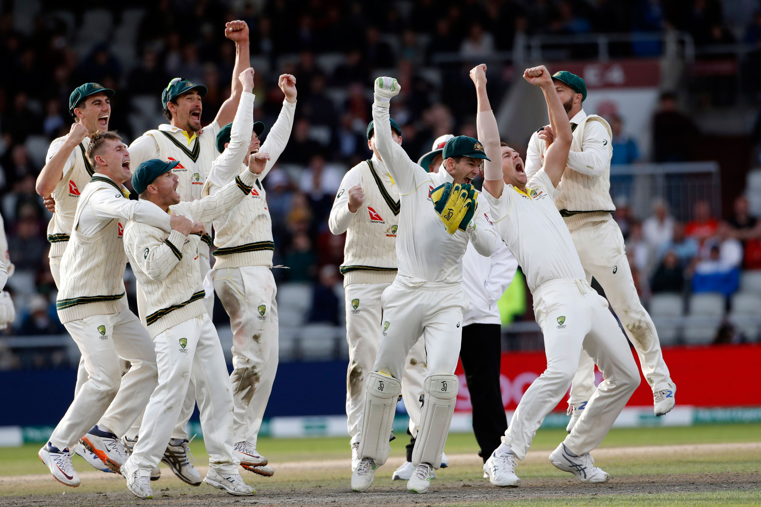 Australian players celebrate after winning the fourth test and retaining the Ashes during day five of the fourth Ashes Test cricket match between England and Australia at Old Trafford in Manchester, England, September 8, 2019.