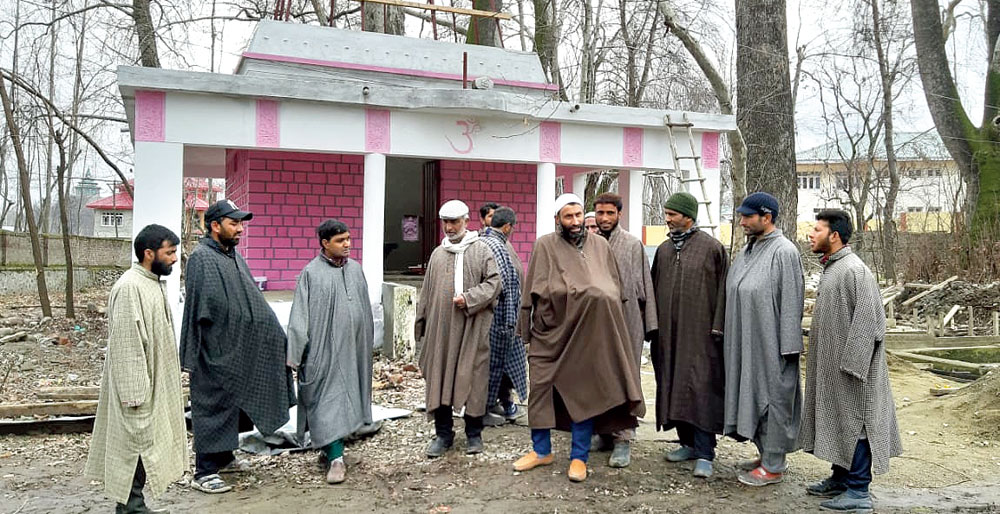 Villagers outside the temple in Pulwama.