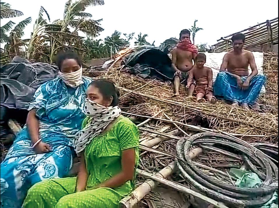 Priyatama with her mother Pratima at their ravaged home.