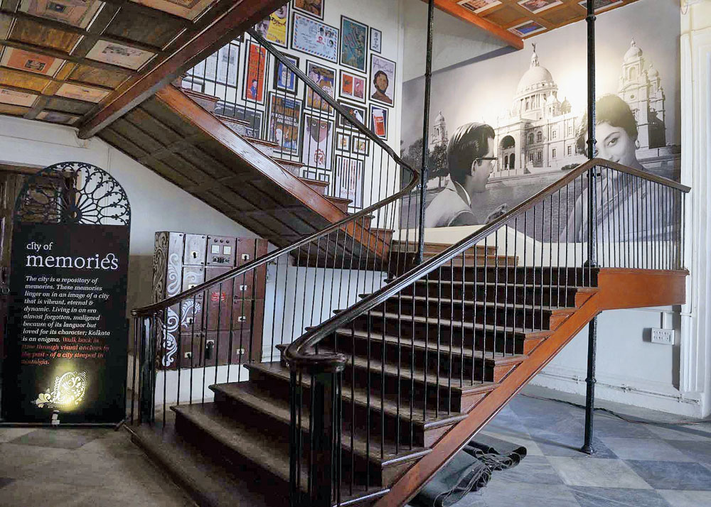 A wooden staircase leading to the first floor where the Ami Kolkata exhibition is being held