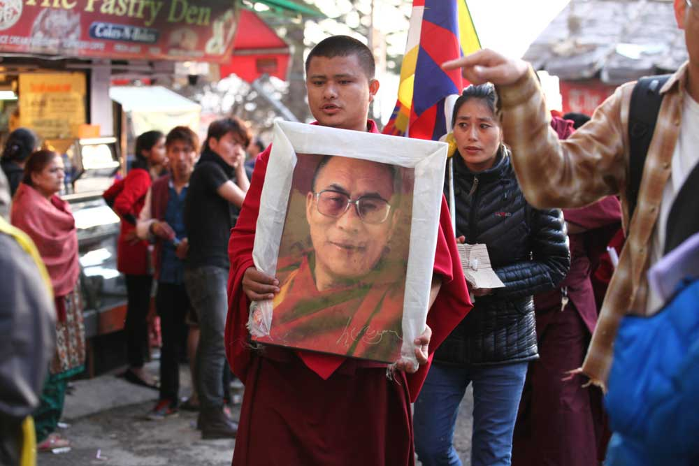 In his book The Buddha And The Borders, journalist Nirmalya Banerjee writes that with the years rolling by, Tibetans increasingly face the dilemma: to remain refugees or accept Indian citizenship to assimilate into a larger society.