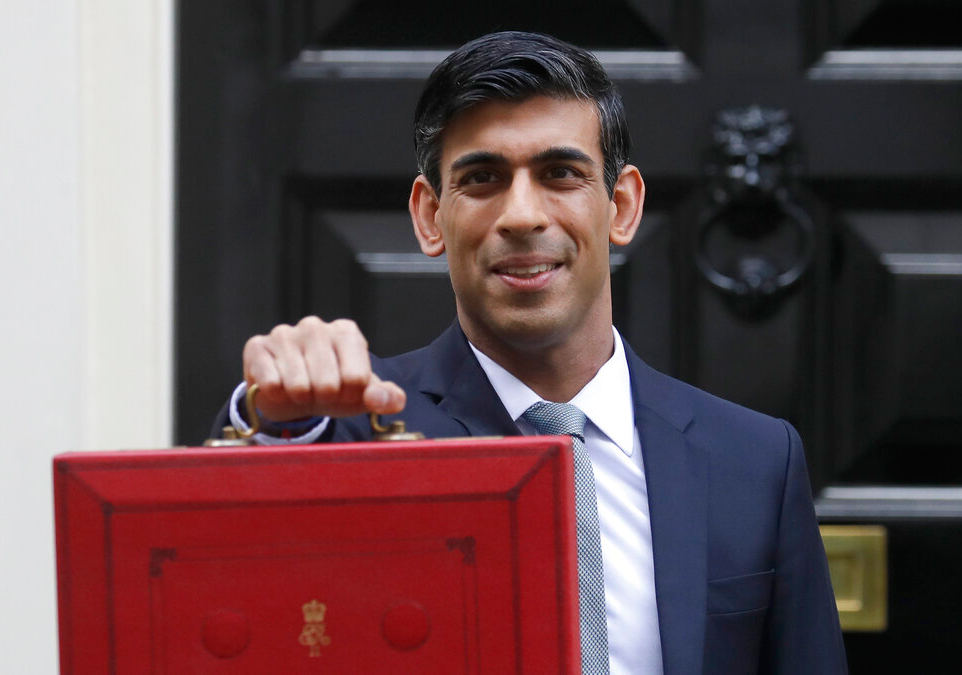 Britain's chancellor of the exchequer Rishi Sunak holds the budget box outside 11 Downing Street on Wednesday.