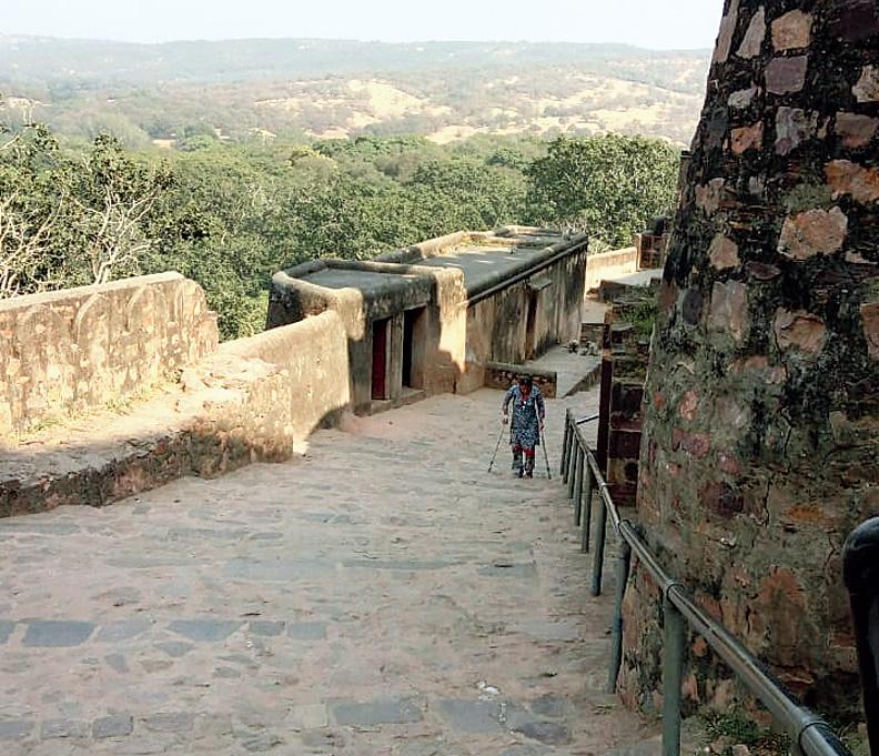 Rita Das climbing up Ranthambore's hill fort on crutches.