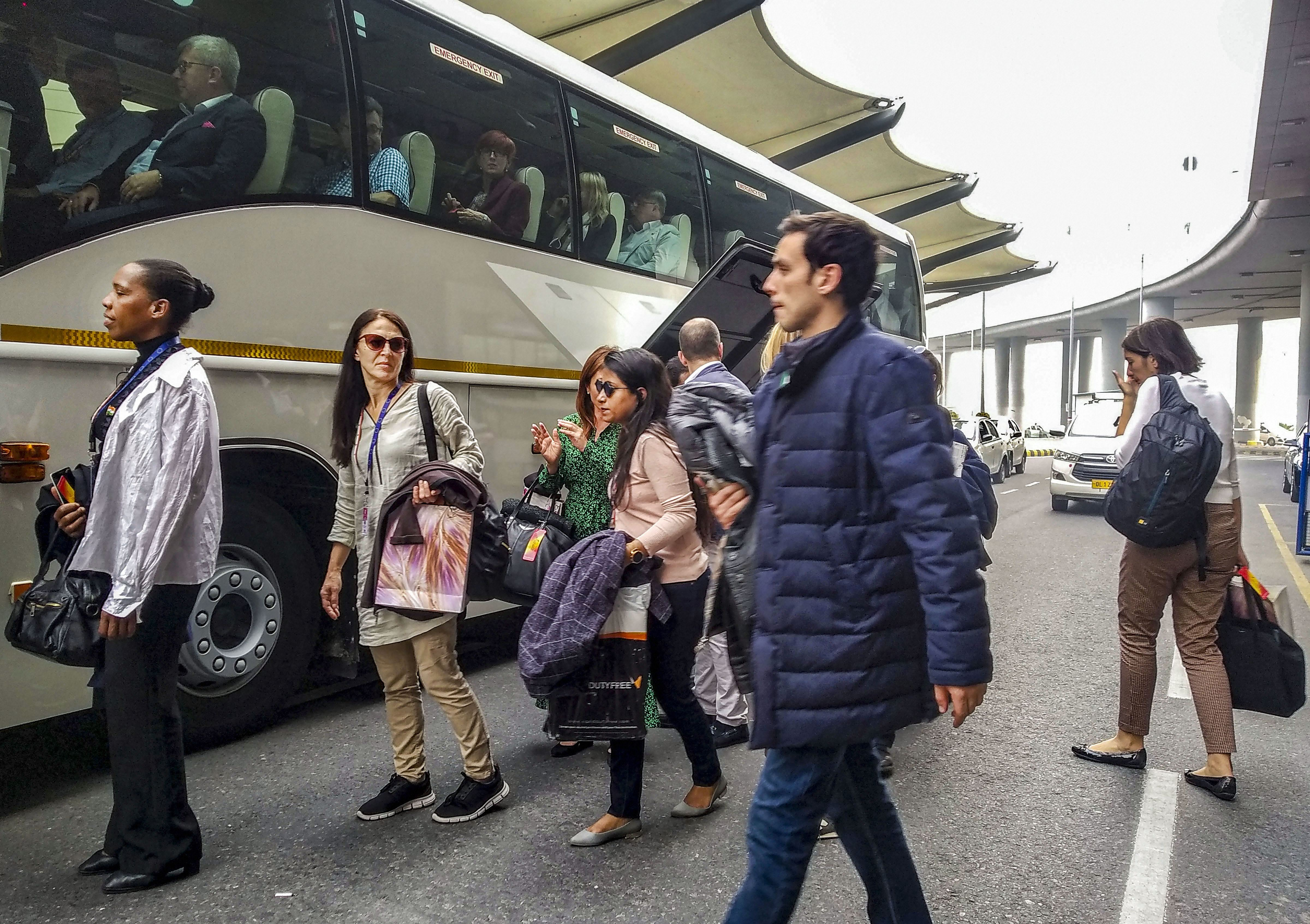 Members of European Parliament board a bus on their arrival at IGI Airport in New Delhi on October 30 after their visit to Jammu and Kashmir.