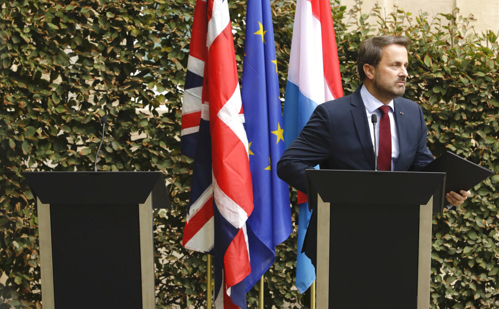 Luxembourg Prime Minister Xavier Bettel addresses a media conference next to an empty lectern intended for British Prime Minister Boris Johnson after a meeting at the prime ministers office in Luxembourg, Monday, September 16, 2019.