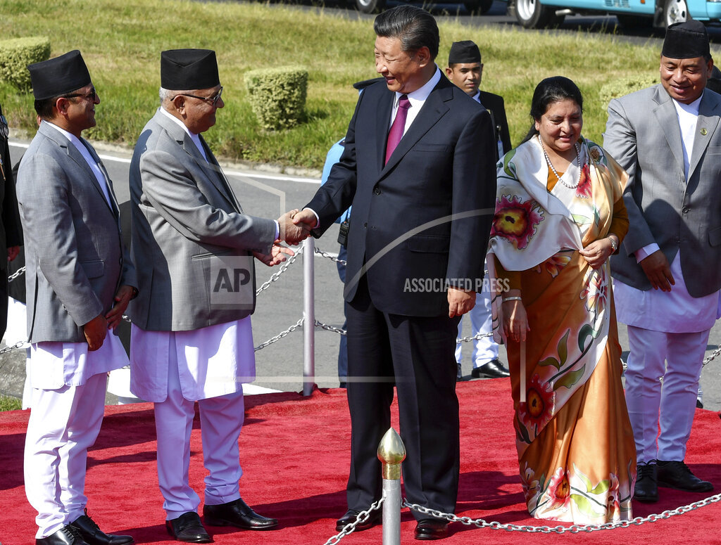 Xi Jinping shakes hands with Nepal's Prime Minister KP Sharma Oli in Kathmandu on October 13, 2019.