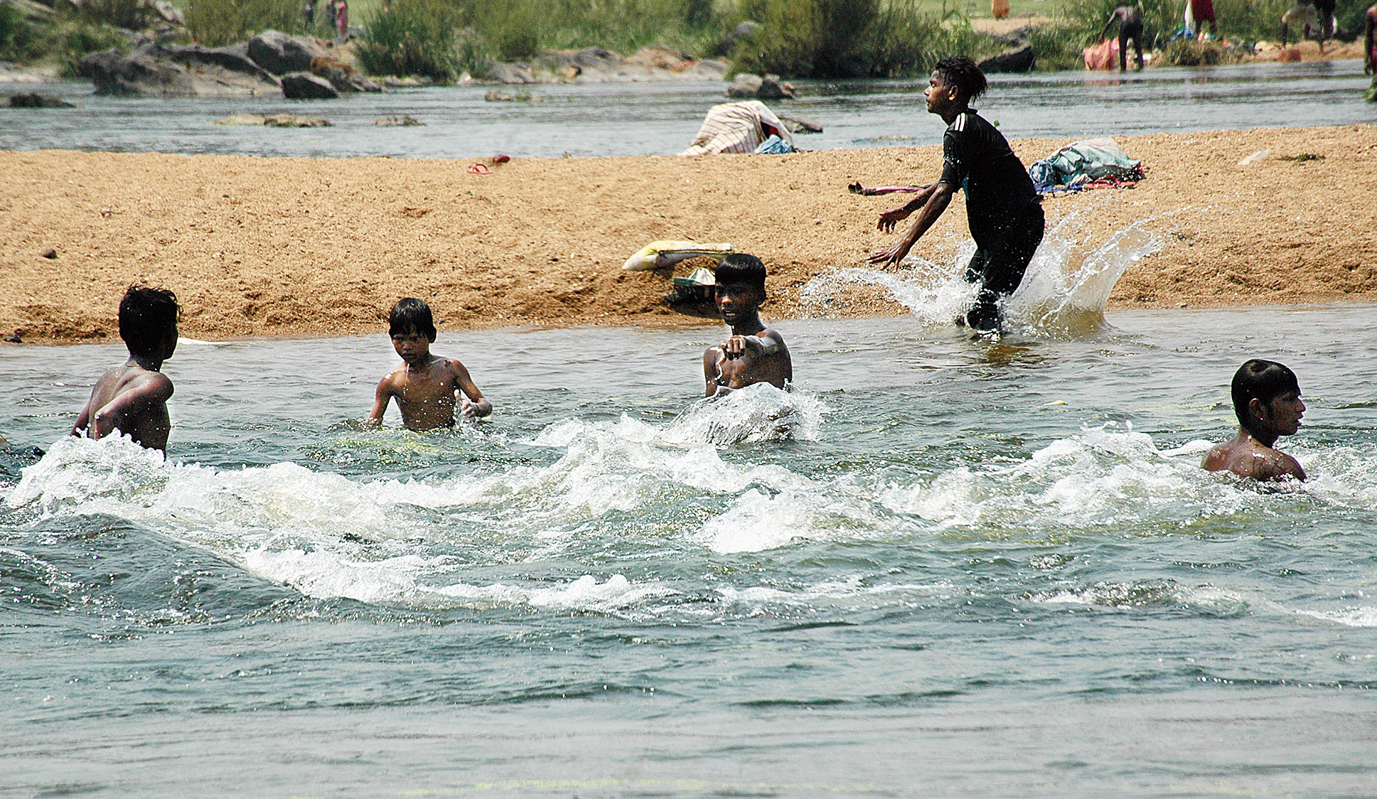 Boys enjoy a swim in Subernarekha on a scorching Monday afternoon in Jamshedpur.