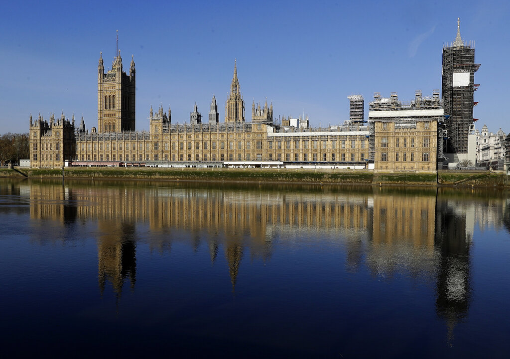 The Palace of Westminster is reflected in the river Thames opposite St Thomas' Hospital in central London as British Prime Minister Boris Johnson was moved to intensive care after his coronavirus symptoms worsened in London, Tuesday, April 7, 2020. Johnson was admitted to St Thomas' hospital in central London on Sunday after his coronavirus symptoms persisted for 10 days. Having been in hospital for tests and observation, his doctors advised that he be admitted to intensive care on Monday evening.