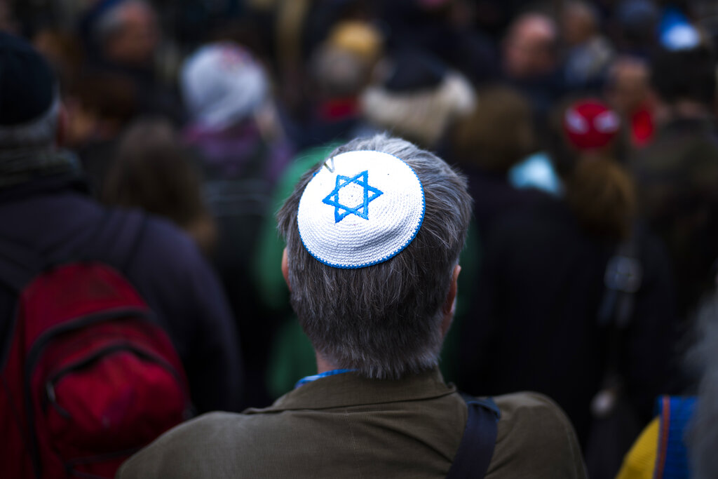 In this April 25, 2018 file photo, a man wears Jewish skullcap, as he attends a demonstration against an anti-Semitic attack in Berlin. Far-right and far-left politicians have often learned to project themselves as defenders of Jews while drawing on blatantly anti-Semitic tropes