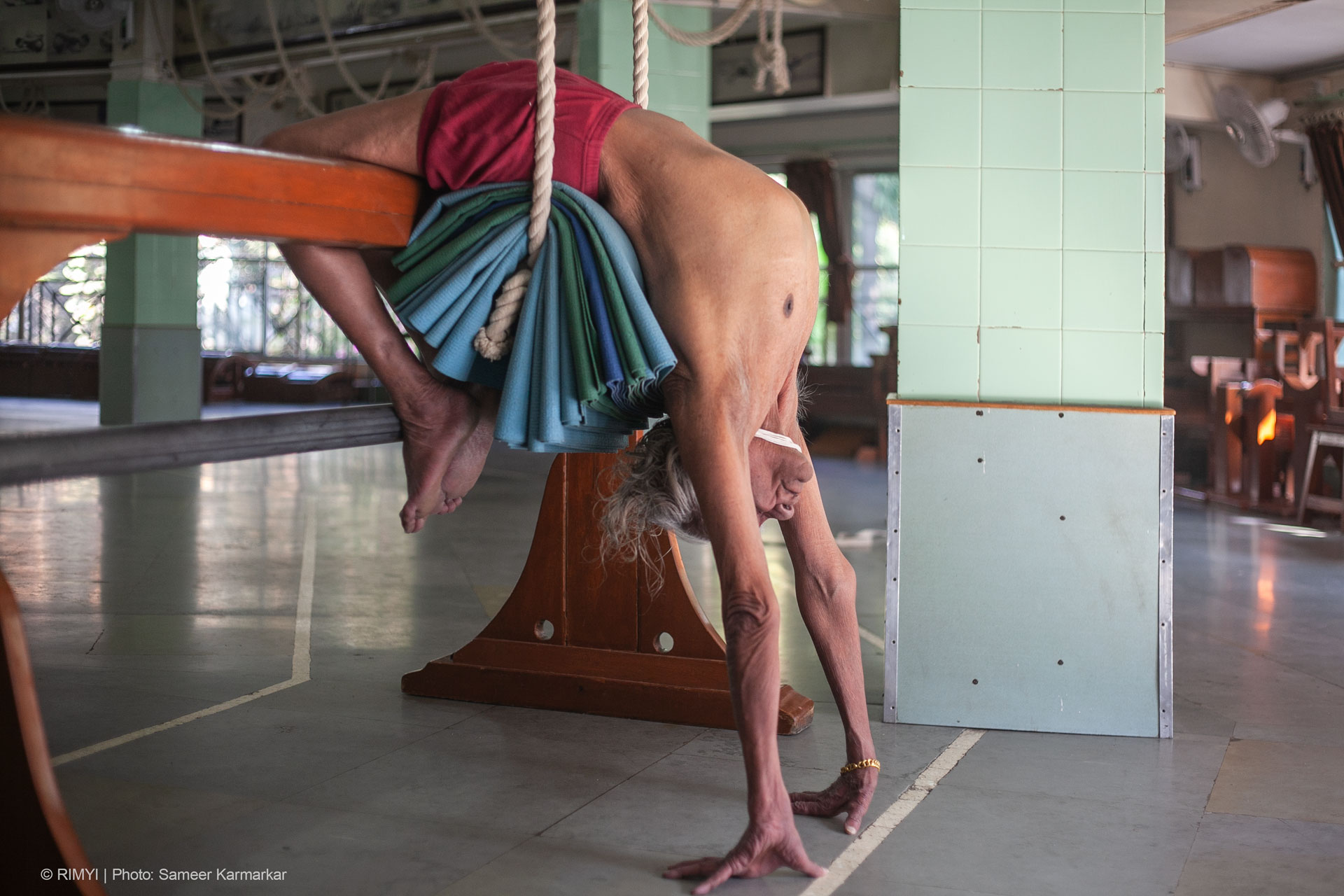 Iyengar was the first to introduce props like wooden bricks, benches, belts, and ropes into yoga.