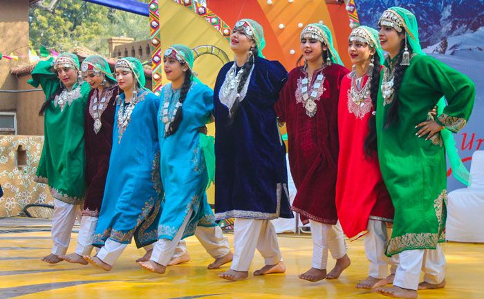 Folk artists from Jammu and Kashmir perform at the chaupal during the 34th International Surajkund Crafts Mela, in Faridabad