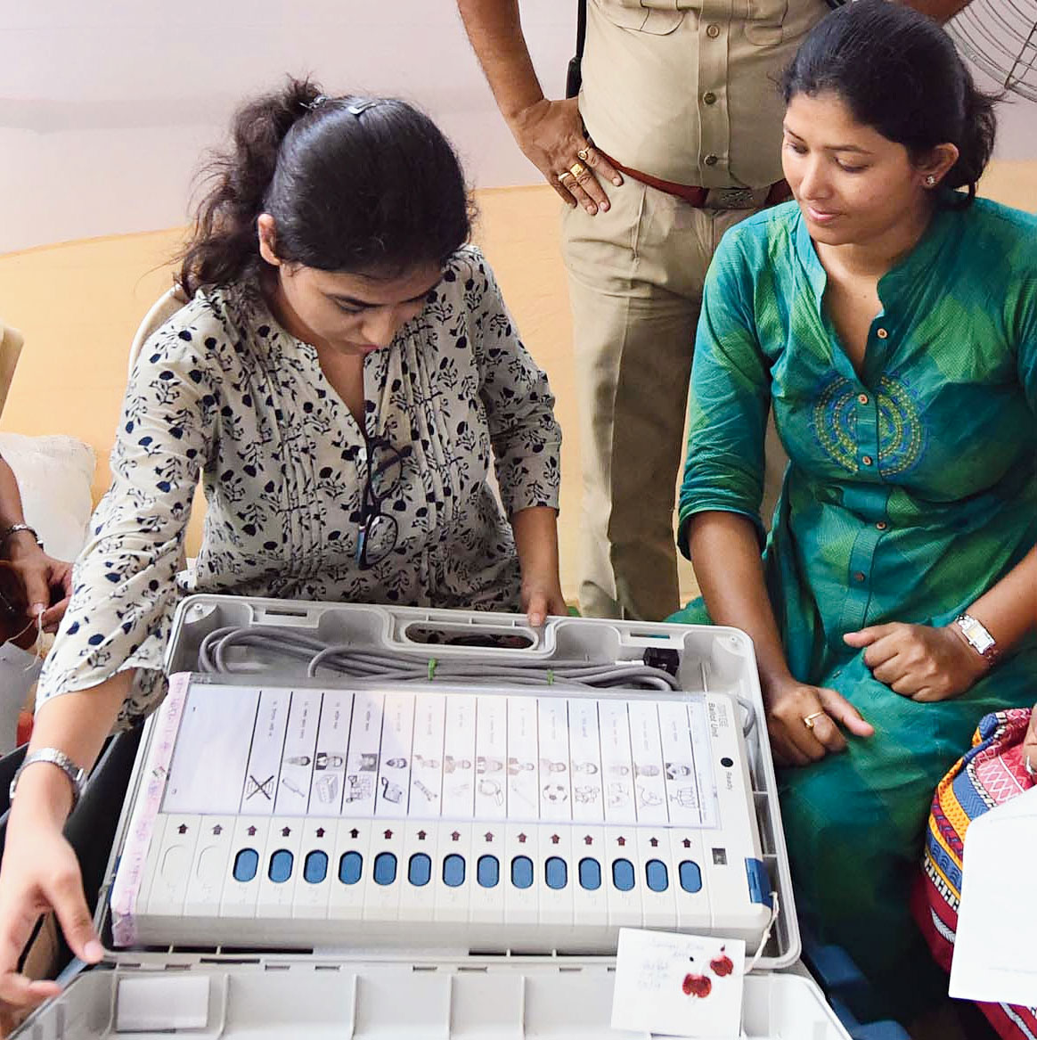 Officers at Hastings House, Alipore, on Saturday, prepare for polling day.