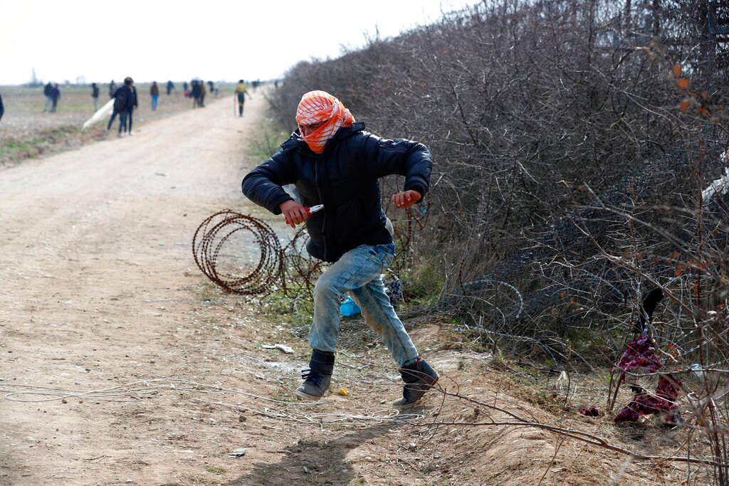 A migrant runs during clashes with Greek police in Edirne, Turkey, on March 2