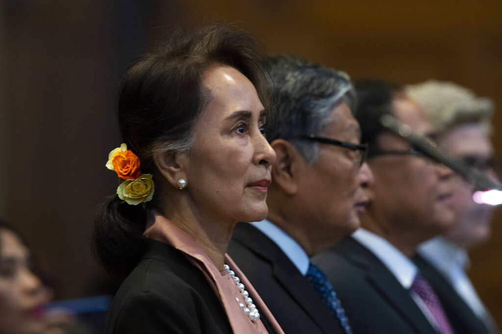 Myanmar's leader Aung San Suu Kyi stands in the court room of the International Court of Justice for the first day of three days of hearings in The Hague, Netherlands, Tuesday, December 10, 2019