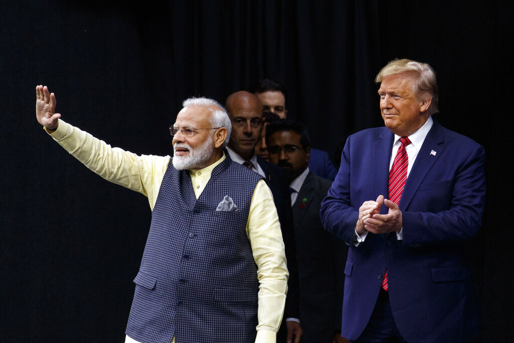 President Donald Trump stands on stage with Prime Minister Narendra Modi at NRG Stadium, in Houston, Texas, on Sunday, September 22, 2019, at an event titled