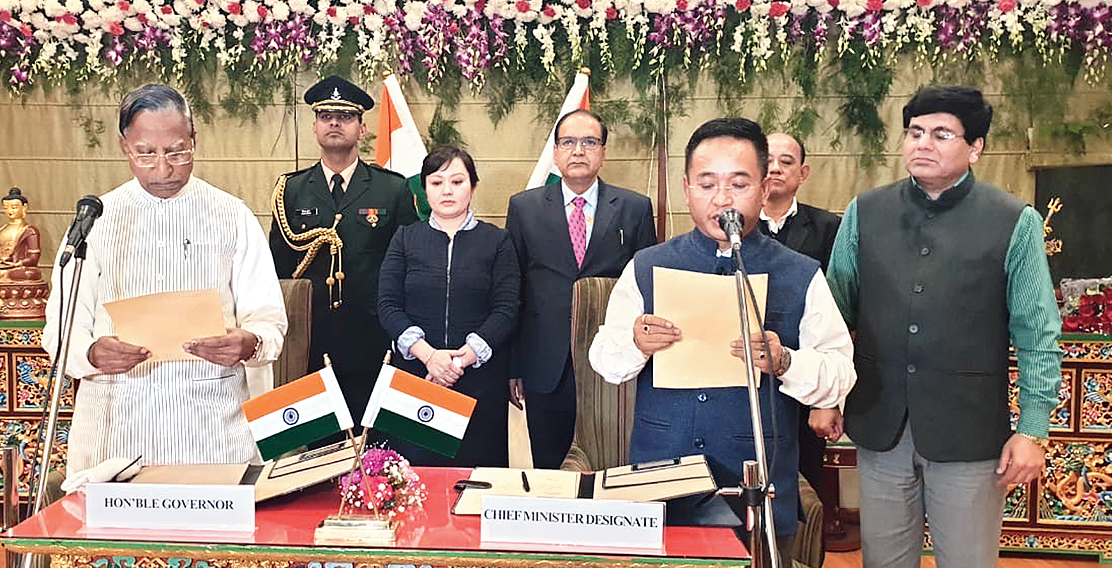 Sikkim governor Ganga Prasad administers oath to PS Tamang in New Delhi on Saturday.