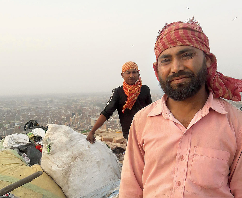 Wholesaler Saidul Sheikh (in the foreground), who lives and works out of the khatta
