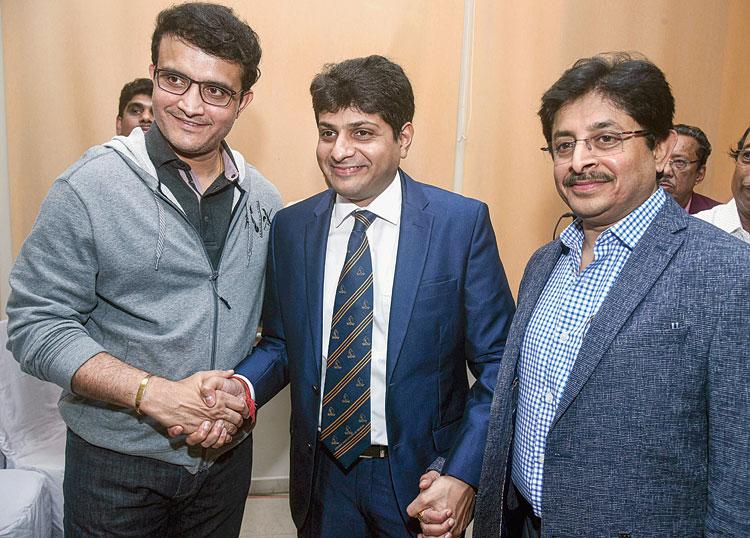 BCCI president Sourav Ganguly with newly appointed CAB president Avishek Dalmiya (centre) and secretary, his brother Snehasish Ganguly, on Wednesday