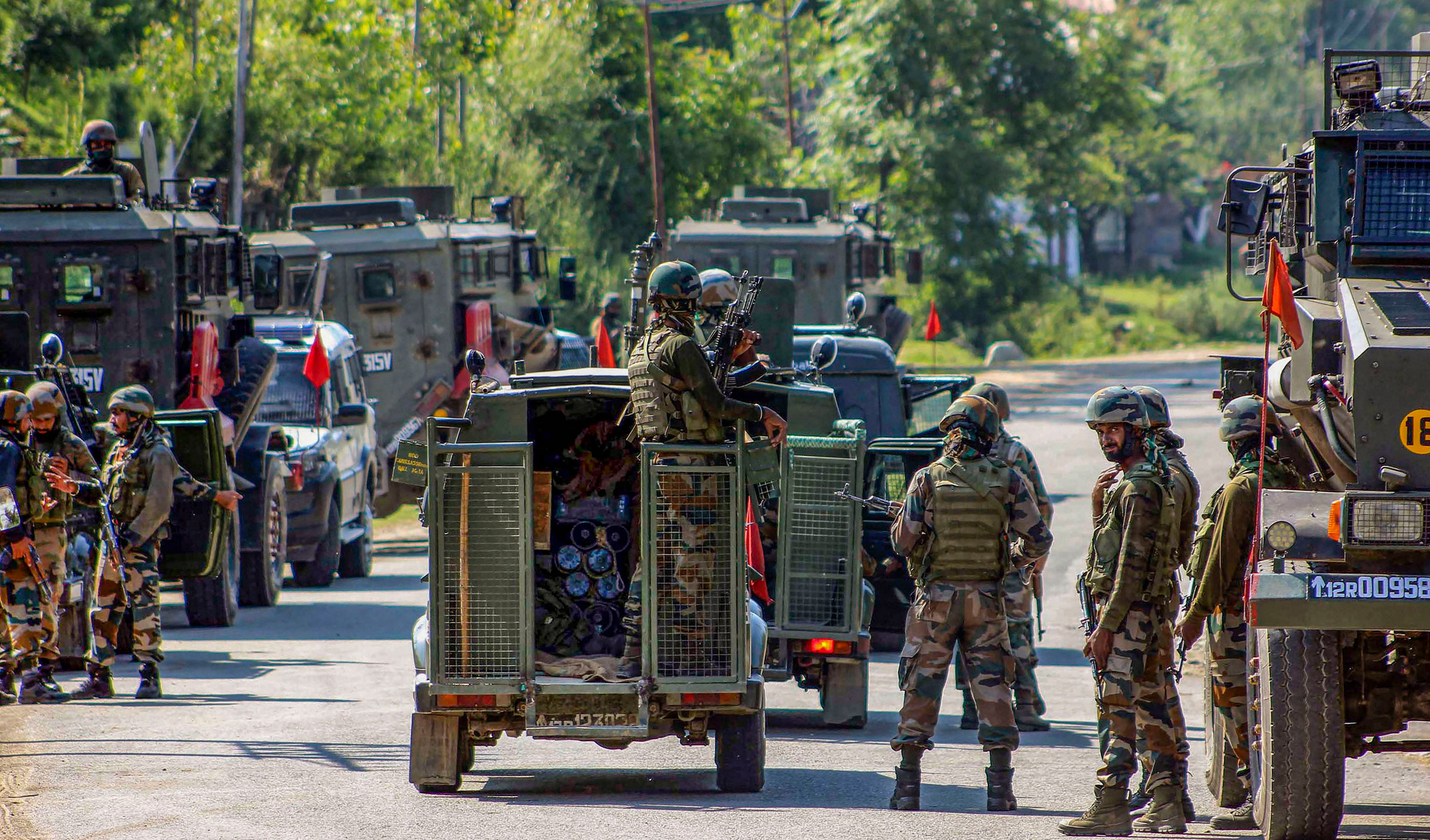 Army soldiers cordon off the area near the house in where the militants were hiding during the encounter in Anantnag on June 17, 2019.