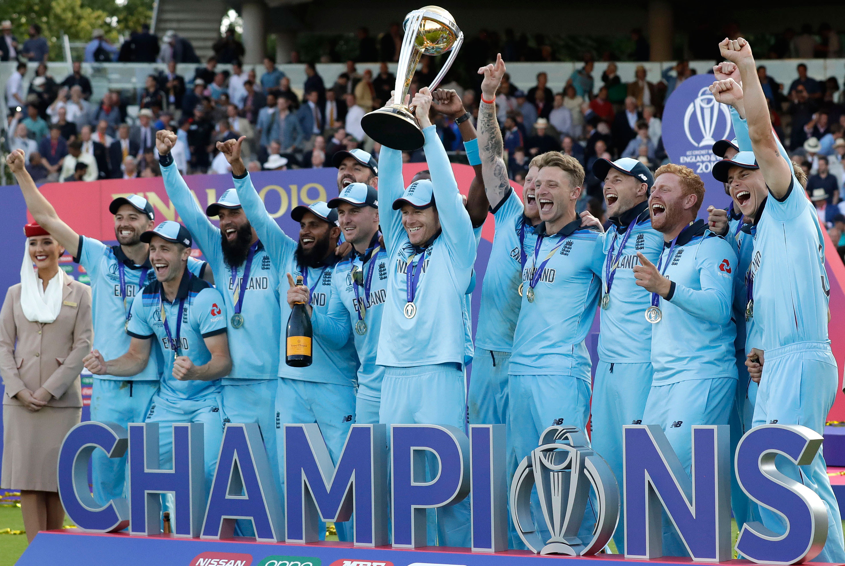 World Champions: England captain Eoin Morgan and teammates celebrate with the trophy at Lord's on July 15, 2019.