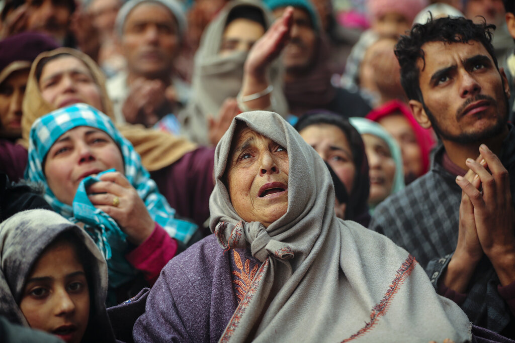 Kashmiri Muslim devotees offer prayer outside the shrine of Sufi saint Sheikh Syed Abdul Qadir Jeelani in Srinagar, December 9, 2019. Hundreds of devotees gathered at the shrine for the 11-day festival that marks the death anniversary of the Sufi saint. The image is part of the photo series that won the 2020 Pulitzer Prize for Feature Photography.