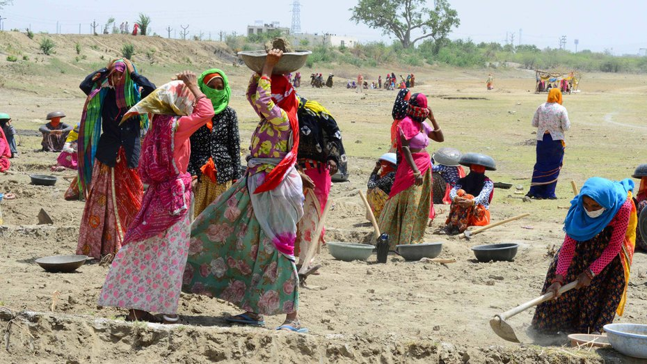 Labourers under MNREGA work at a site in Beawar.