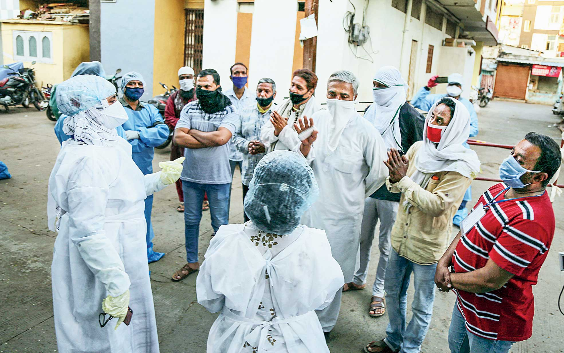 Residents of Taatpatti Bakhal in Indore apologise to a team of doctors on Thursday, a day after health workers were attacked when they went there to quarantine relatives of a Covid-19 patient. Seven suspected attackers have been arrested.