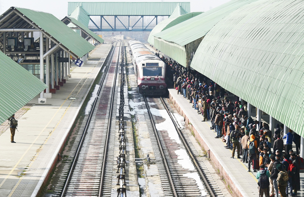 Passengers wait as Baramulla-Srinagar-Banihal bound train arrives at a station in Srinagar, Sunday, November 17, 2019. The rail service in Kashmir valley was fully resumed after it was suspended on 3rd August ahead of centre decision of abrogation of article 370.
