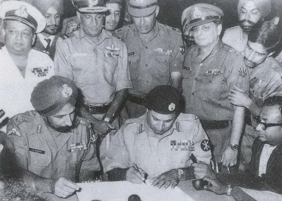 Lt Gen Amir Abdullah Khan Niazi signs the Instrument of Surrender under the gaze of Lt Gen Jagjit Singh Aurora in Dhaka on December 16, 1971. R&AW is said to have played a key role in the creation of Bangladesh
