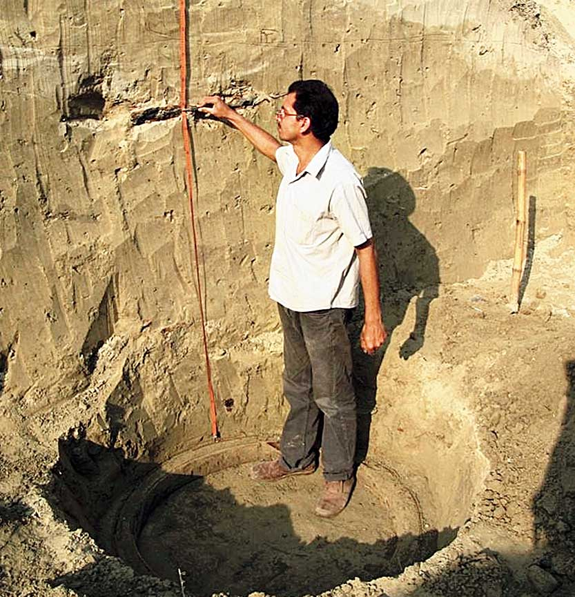 Shanker Sharma points out the thick silt deposit over a chance discovery of a ring well belonging to the Gupta age.