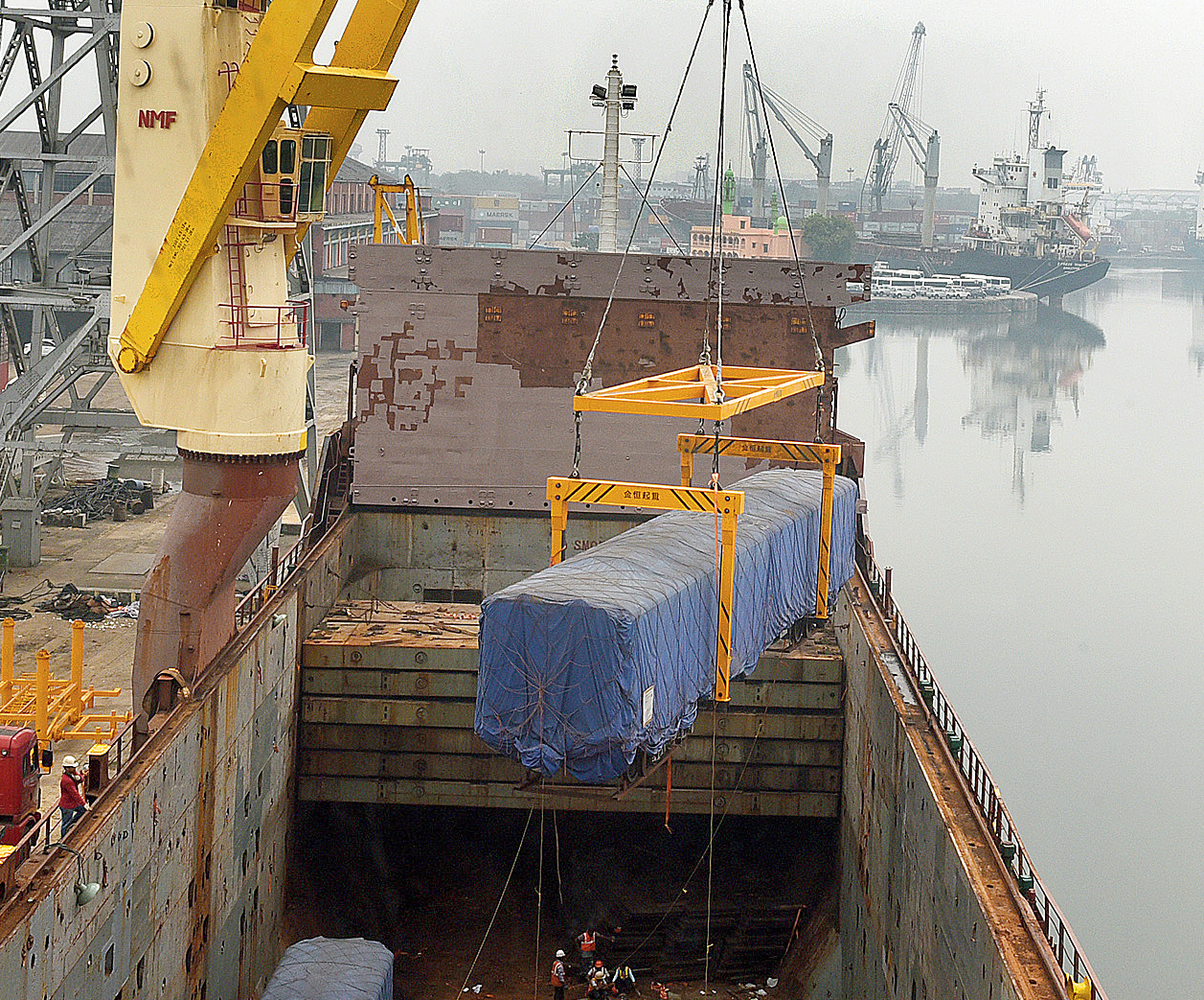 One of the coaches of the Chinese rake built for the north-south Metro being lifted from a cargo vessel at Garden Reach on Monday.
